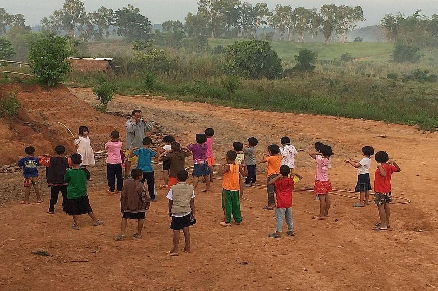 In 2007, Mr Eugene Wee (above) set up non-profit group Radion International in Khek Noi village in northern Thailand, which shelters underprivileged children (left) there.
