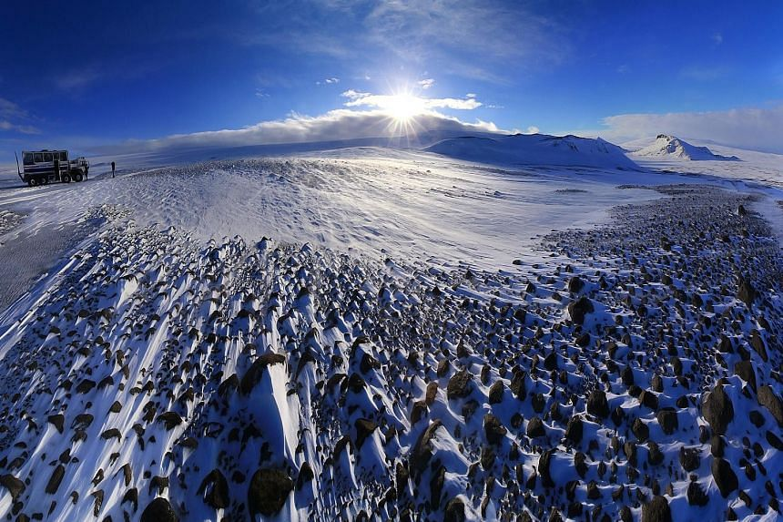 """The powdery- white landscape (left) on the journey to Langjokull glacier. An entrance in the Langjokull glacier leads to a 400m-long tunnel (above) which ends at an icy """"cathedral"""" (right)."""