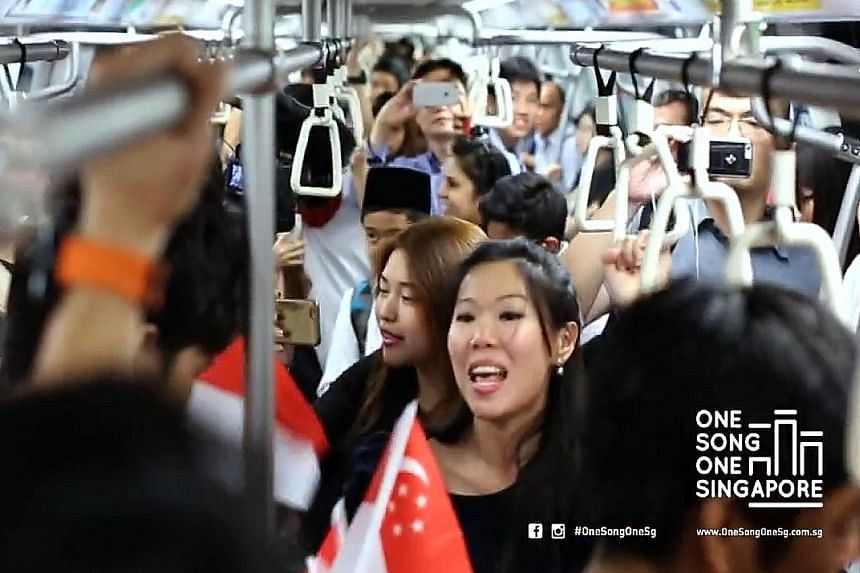 A video of commuters participating in a flash mob event on a crowded train, singing along to the National Day favourite Home, has garnered more than 330,000 views.