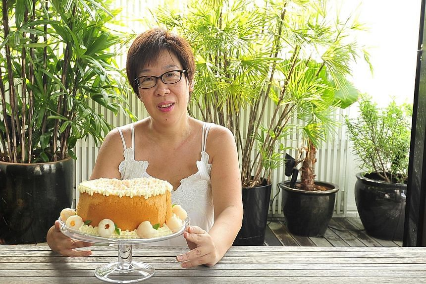 Ms Angeline Lim garnishes her rose chiffon cake with lychees and lime basil leaves.