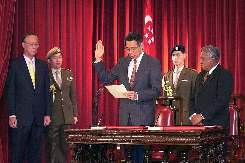 Mr Goh, Mr Lee Hsien Loong and then President S R Nathan at Mr Lee's swearing-in ceremony. Mr Lee took over as Prime Minister in August 2004.