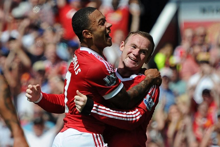 "Manchester United's Dutch midfielder Memphis Depay (left) celebrates with striker Wayne Rooney after an inadvertent prod by Tottenham's Kyle Walker beat his own goalkeeper Michel Vorm for the only goal of the match. Louis van Gaal said: ""I think it w"