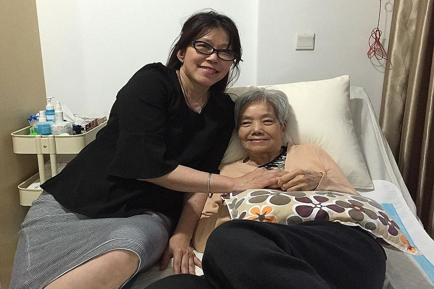 Ms Patsy Chia with her mother Mary Lai. Ms Chia wrote her book after being Madam Lai's caregiver for eight years.