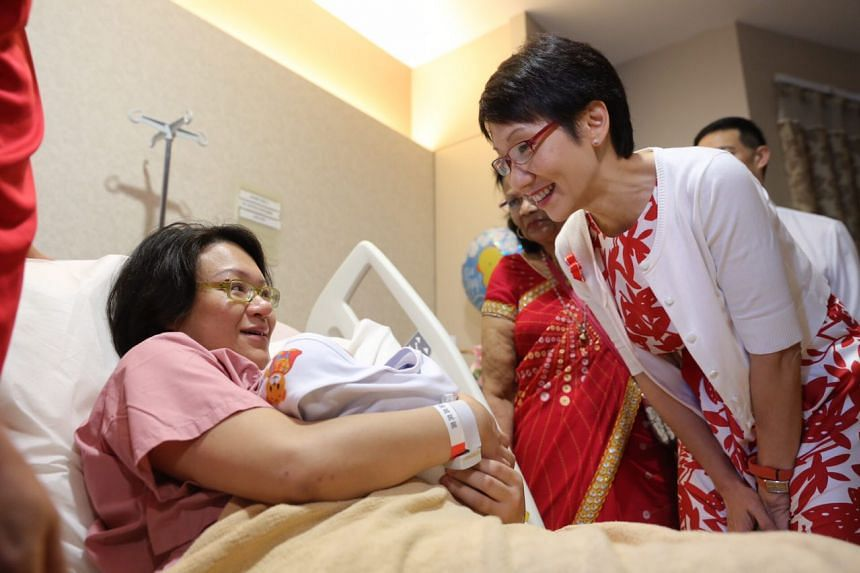 Minister Grace Fu at KK Hospital visiting Ms Angeline Lim, 35, and her jubilee baby boy Ryker Jedd Ng. Ms Lim's husband Mr Ng Ming Jay, 45, is also present.