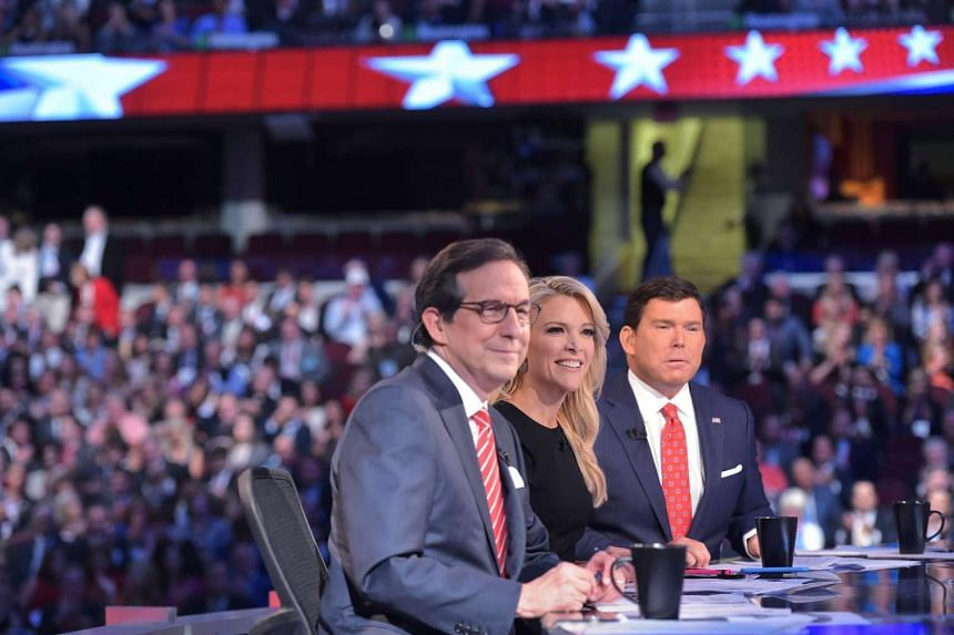 Moderator Megyn Kelly (centre) flanked by fellow moderators Chris Wallace (left) and Bret Baier (right) at the Republican debate.