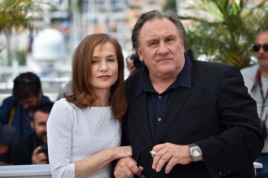French actor Gerard Depardieu and actress Isabelle Huppert pose during a photocall for the film Valley Of Love at Cannes in 2015.