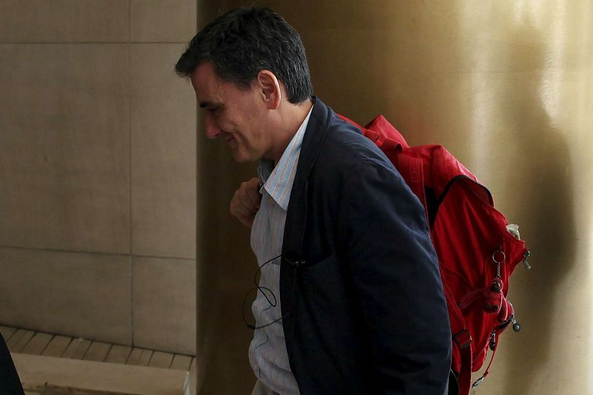 Greek Finance Minister Euclid Tsakalotos arrives for a meeting with representatives of the IMF, the European Commission, the ECB and the euro zone's rescue fund, European Stability Mechanism.
