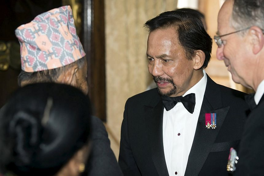 Brunei's Sultan Hassanal Bolkiah (centre) will be one of the foreign dignitaries from 18 countries attending today's National Day Parade.
