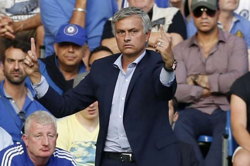 Mourinho gestures from the touchline during the match between Chelsea and Swansea City.