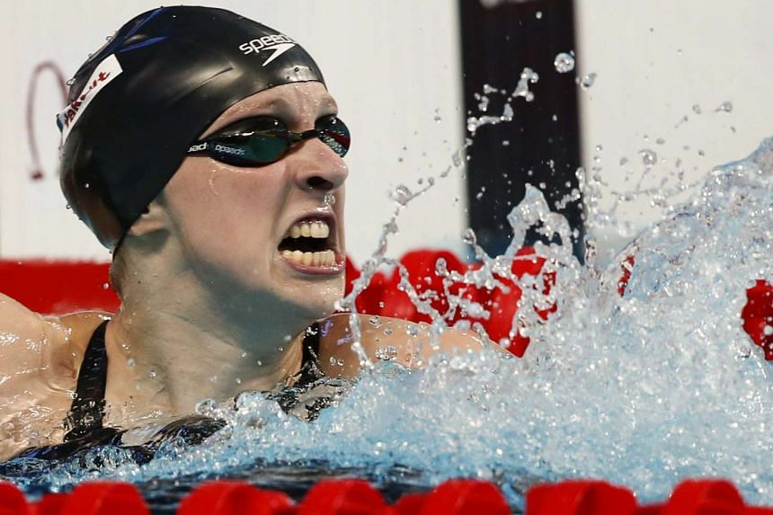Ledecky of the US celebrates after setting a new world record and winning the women's 800m freestyle final.