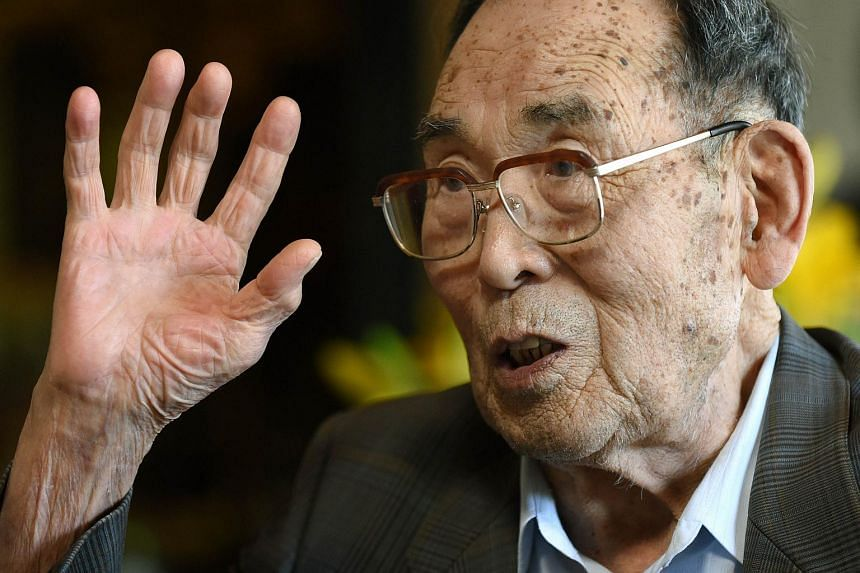 In this photograph taken on June 25, 2015, former Japanese fighter pilot Kaname Harada, 98, gestures as he tells his experience during World War II at his home in Nagano, Nagano Prefecture.