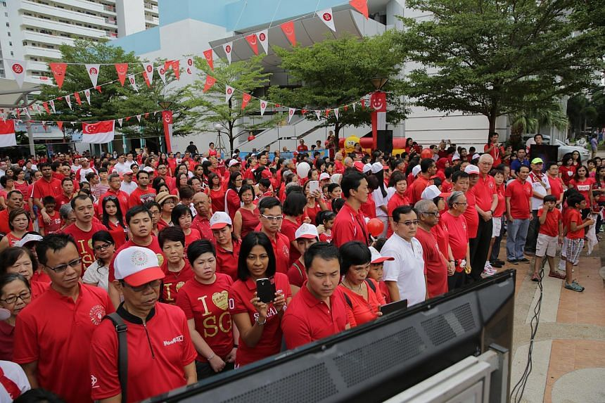 Marine Parade residents during the proclamation moment at the National Day Observance Ceremony at Marine Parade Terrace.