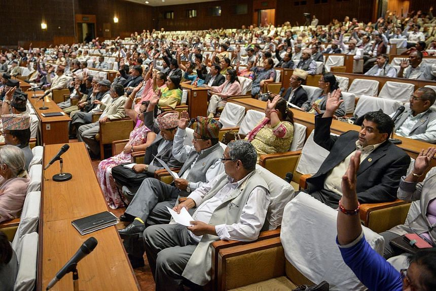Nepalese lawmakers meet at the national parliament in Kathmandu on June 9, 2015.