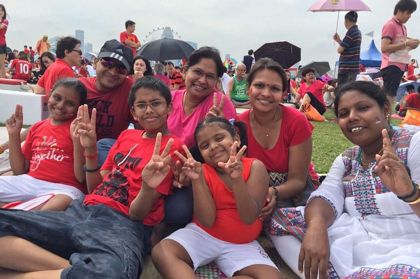 """""""The Black Knights were the best!"""" says  Sanjjeev Ganesan (front row, second from left), 11, whose family is at the Marina Barrage to catch the fireworks later tonight. ST PHOTO: DANSON CHEONG"""