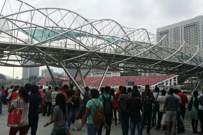 People gather near the Helix Bridge, for a view of the the Floating Platform. ST PHOTO: PRISCILLA GOY