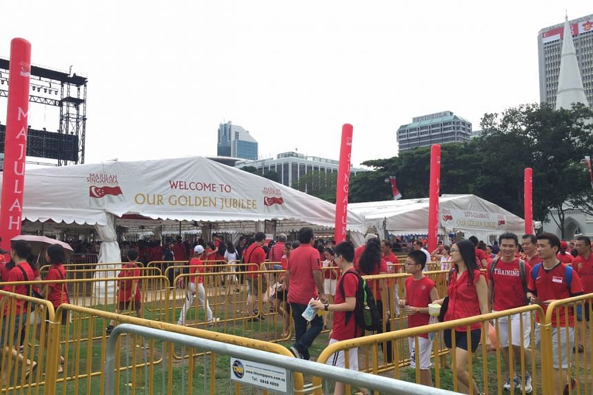Early birds streaming in at the Padang earlier today. ST PHOTO: AUDREY TAN