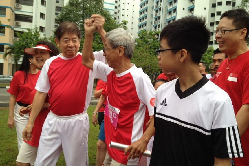 Minister for National Development Khaw Boon Wan and Sembawang GRC MP joining Pioneer Generation residents at the SG50 50km relay run.