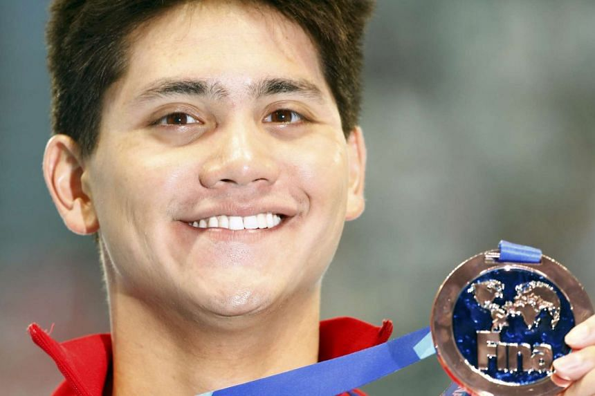 Schooling poses with his bronze medal.