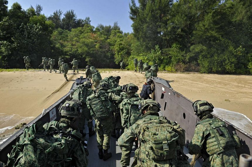 Servicemen from the Singapore Armed Forces participating in a military exercise on Pulau Sudong in August 2011, part of a two-week-long drill to test the battle-readiness of Singapore's air force, navy and army units.