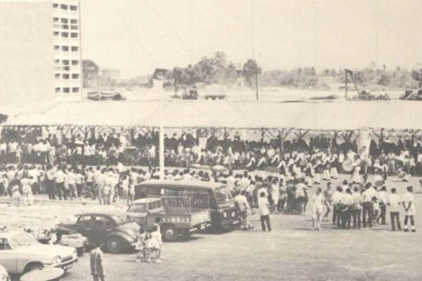 A crowd (above) gathering at a balloting exercise in 1966 for the first batch of home-ownership flats in Toa Payoh.