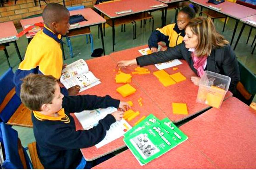 Above: Ms Adele Piccolo, a deputy principal at Sacred Heart College in Johannesburg, South Africa, has been using Singapore mathematics textbooks to teach her pupils. The school started using the Singapore maths curriculum in January 2010.