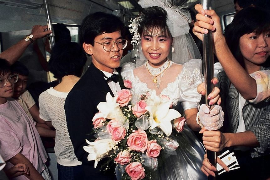 On Nov 7, 1987, Mr Chan Kian Guan, then 27, and his bride, Ms Judy Aw, then 24, started their married life by taking a ride on the newly opened MRT system. They also invited their friends and family on the train ride. Mr and Mrs Chan reprised their w