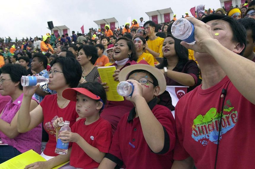 At the urging of parade host Gurmit Singh, 60,000 people opened Newater bottles and drank to Singapore's 37th National Day.
