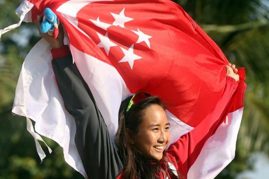 Audrey Yong celebrating her gold in the Women's Windsurfing RSX during June's SEA Games.