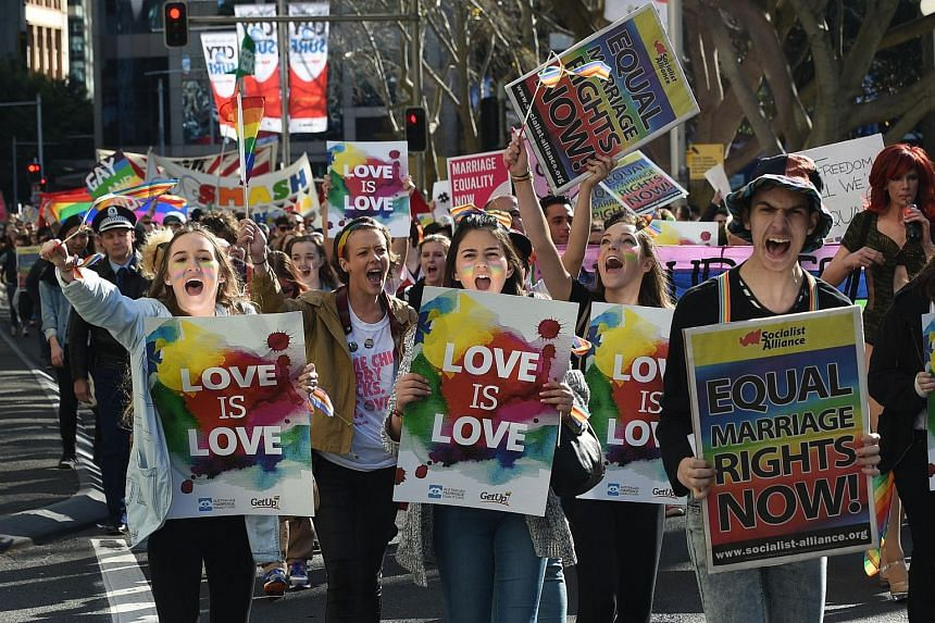 Supporters of same-sex marriage shout slogans as they take part in a rally in Sydney on Aug 9, 2015.