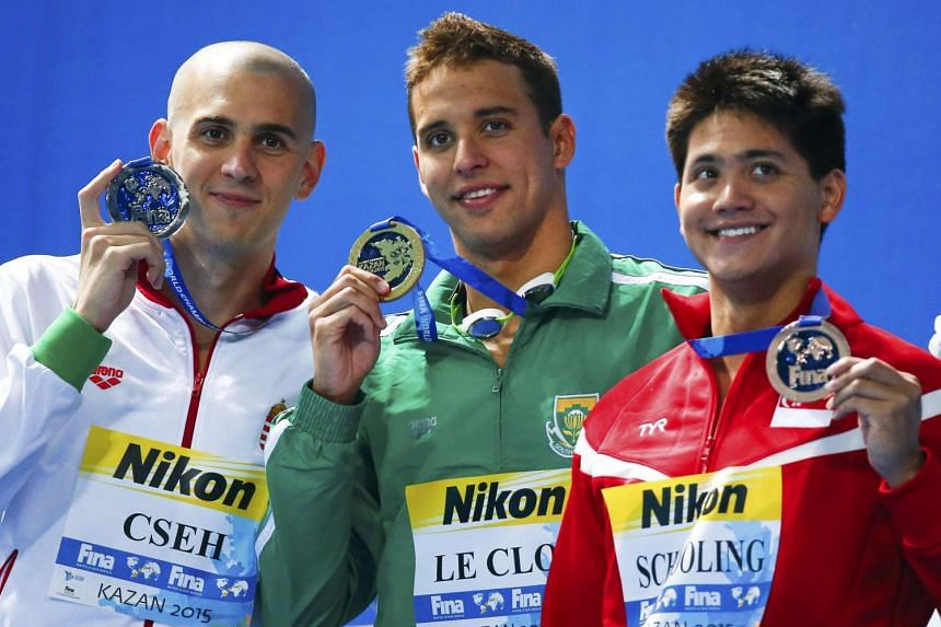 (From left) Hungary's Laszlo Cseh, Chad le Clos of South Africa, and Singapore's Joseph Schooling pose with their medals after the men's 100m butterfly final.