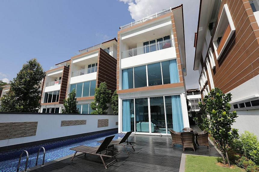 A view of the exterior with lap pool.
