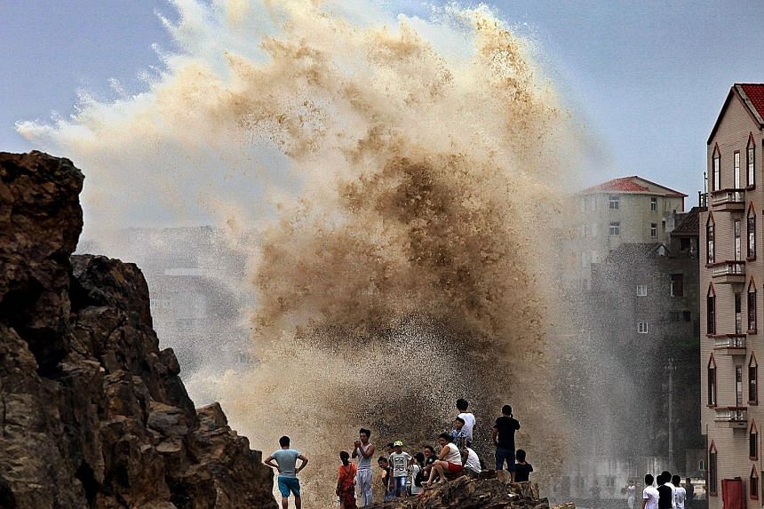 Towering waves cast up by raging winds in Wenling city in Zhejiang province as Typhoon Soudelor drew near the coast of China on Saturday.