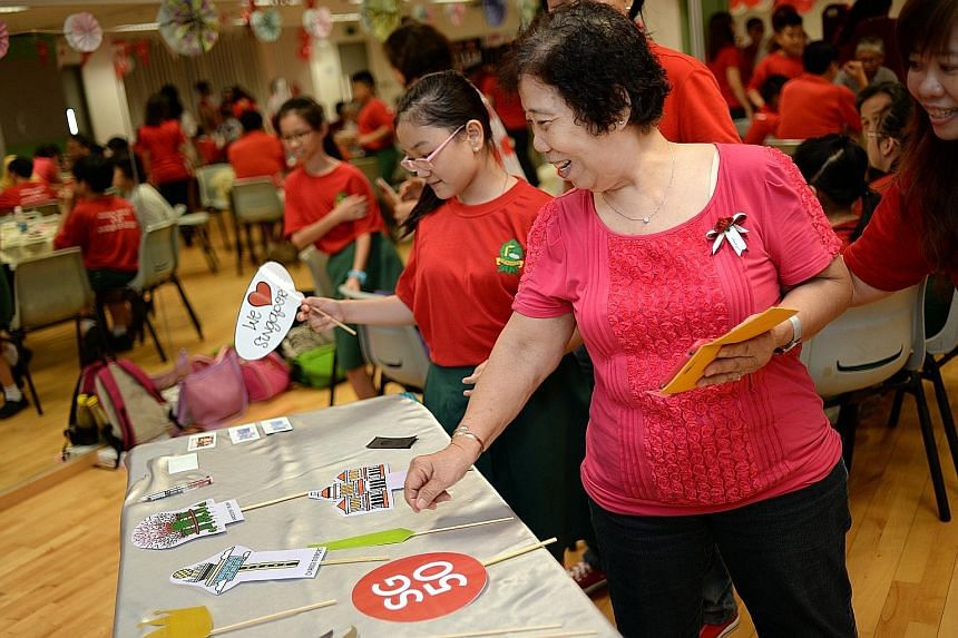 Pupils from Evergreen Primary School doing the Great Singapore Workout, which was popular in schools in the 1990s, as part of its National Day celebrations last Thursday. Cherish Ng, 10, from Evergreen Primary School, with her grandmother, Madam Chon