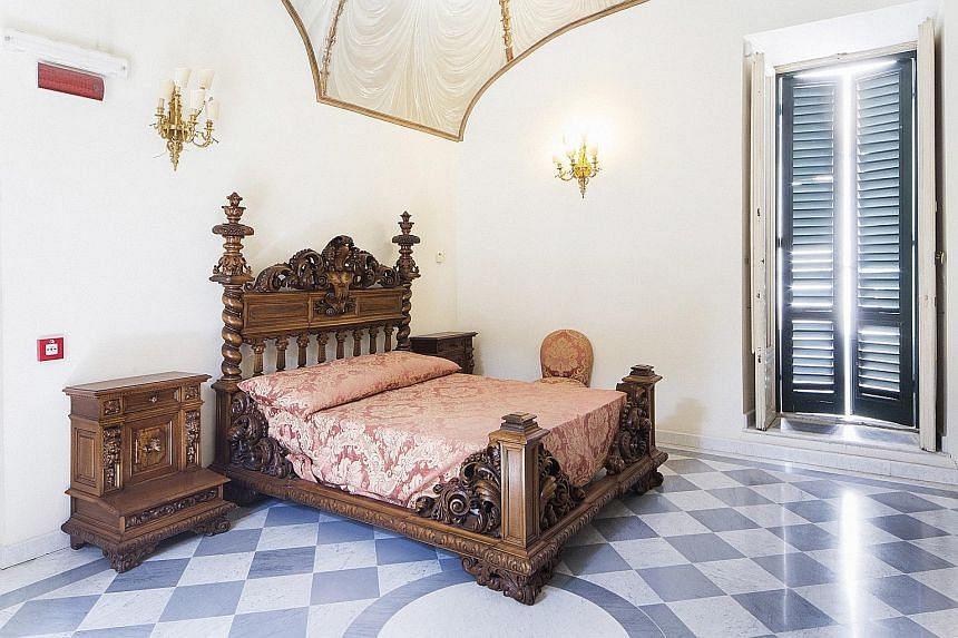 Villa Torlonia had many spaces used by former Italian leader Benito Mussolini, including this bedroom (left).