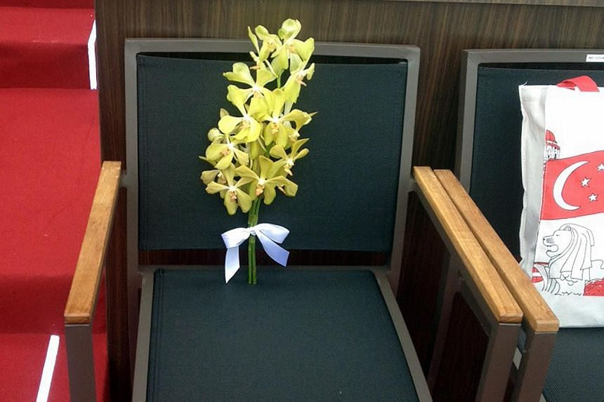 Sprigs of yellow orchid mark this seat in front of the National Gallery at the National Day Parade yesterday, in honour of Mr Lee Kuan Yew.