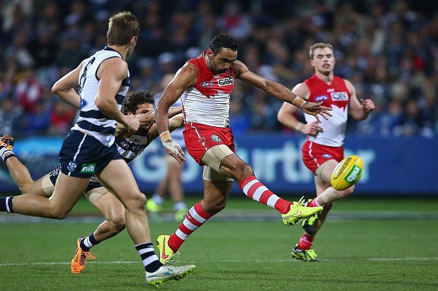 Adam Goodes of the Sydney Swans attempting a shot on goal against the Geelong Cats on Saturday, a game which his team lost by 32 points. Most fans sympathise with his plight and back him, and the stadium was sold out for the first time in two years f