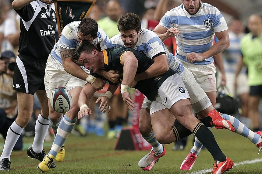 South Africa's full-back Jesse Kriel (centre) is tackled during the 25-37 Rugby Championship Test match loss to Argentina in Durban on Saturday. The defeat, the first at the hands of the Pumas in 22 years, followed losses to Australia and New Zealand