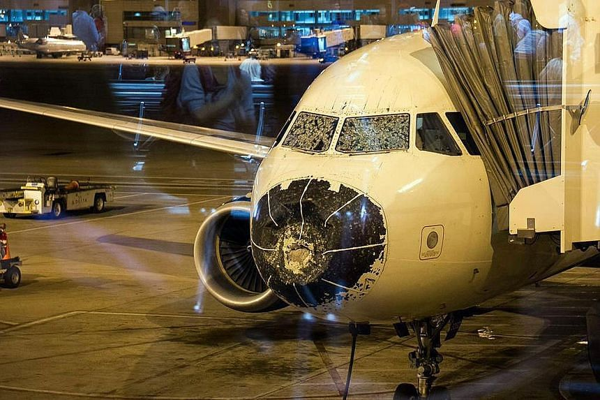 Delta Airlines Flight 1889 was forced to make an emergency landing in Denver after it ran into a hailstorm and suffered damage to its cockpit windshields and nose cone.