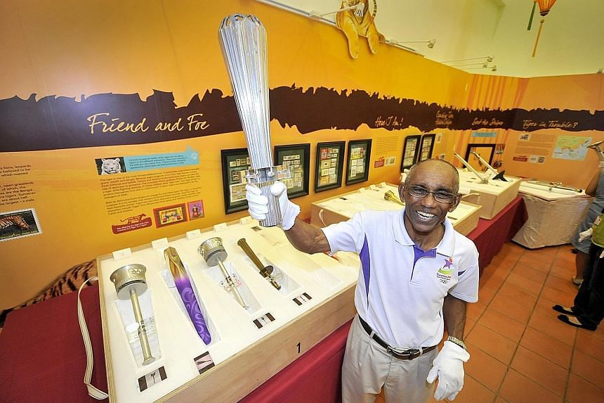 Mr C. Kunalan with a torch from the 1968 Olympic Games in Mexico. He clocked a national record time of 10.38sec in the 100m at the Games. It stood for 33 years.