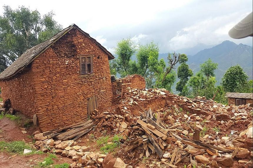 Nepalese building rice bag houses in a village near Pokhara (left), after April's devastating earthquake destroyed thousands of homes (above).
