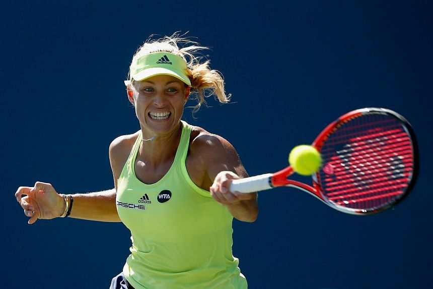 Angelique Kerber of Germany returns a shot to Karolina Pliskova of the Czech Republic during the finals at Stanford University Taube Family Tennis Stadium on Aug 9, 2015 in Stanford, California.