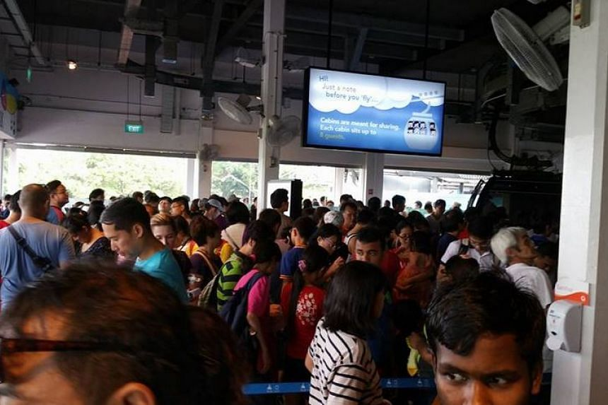 """The packed """"free"""" queue for the Singapore Cable Car."""
