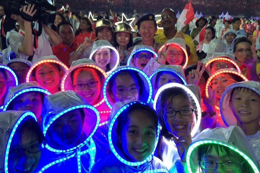 Some of the primary school performers, still decked out in their LED costumes, after the parade.