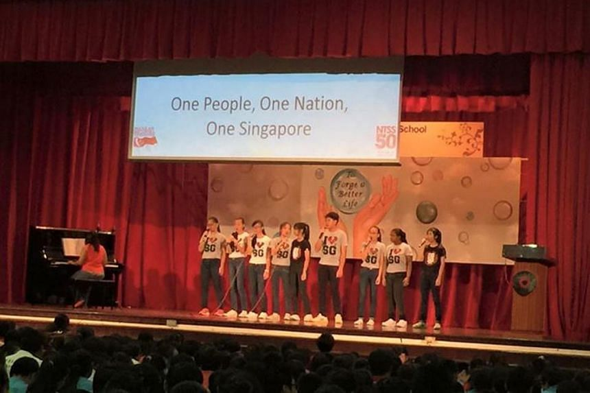 New Town Secondary School celebrating SG50 with songs, speech and opening of a Time Capsule.
