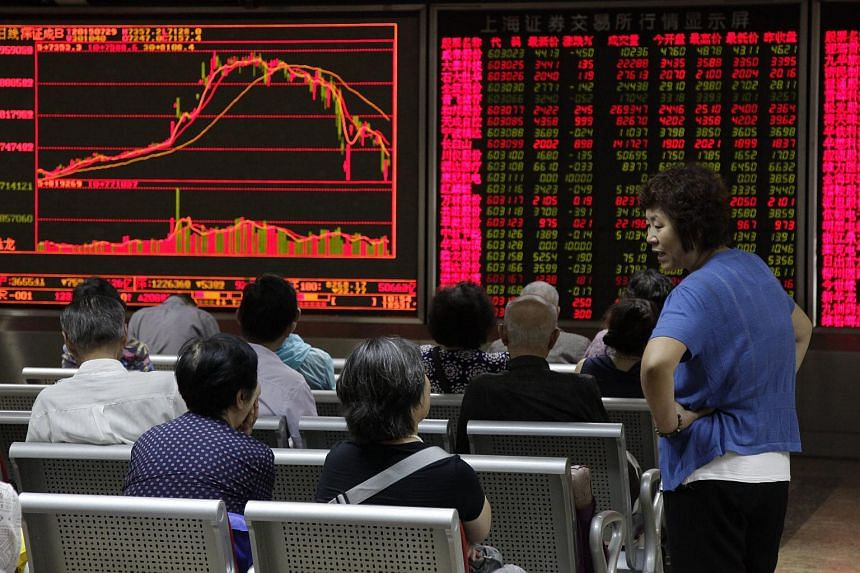 Investors monitor stock market data displayed on an electronic board at a securities brokerage house in Beijing, China, on July 29, 2015.