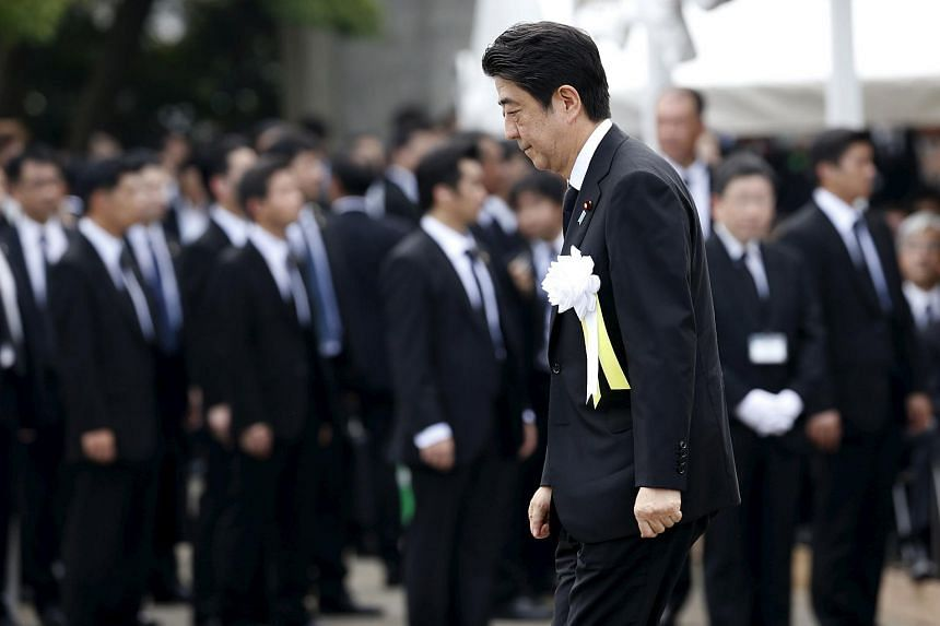 Japan's Prime Minister Shinzo Abe attends a ceremony commemorating the 70th anniversary of the 1945 atomic bombing of the city of Nagasaki.
