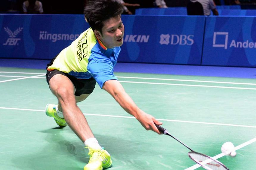 Singapore's Derek Wong returning the shuttle during the men's badminton tournament against Cheng Phor Rom of Cambodia during the 28th Sea Games held at Singapore Indoor Stadium on  June 13, 2015.