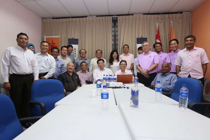 Representatives from the various opposition parties pose for a picture after a second round of talks to avoid three-cornered fights, at the National Solidarity Party's headquarters on Aug 6, 2015.
