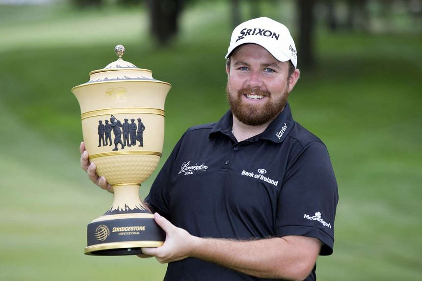 Shane Lowry holds the Gary Player Cup after winning the Bridgestone Invitational at Firestone Country Club - South Course on Aug 9, 2015.