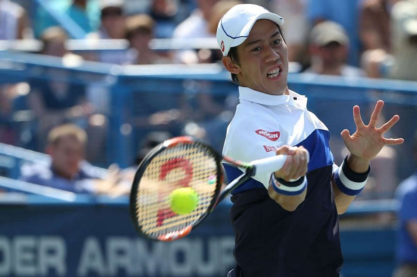 Kei Nishikori of Japan returns a shot to John Isner of the United States in the men's singles final during the Citi Open at Rock Creek Park Tennis Center on Aug 9, 2015 in Washington, DC.